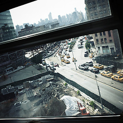 NEW YORK, NY, USA. JUNE 16, 2010. Queens. Traffic viewed from a subway train. Photo: Antoine Doyen