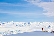 Ian Howat, glaciologist with Ohio State University, looks out over the Chugach Mountains and the main branch of the Columbia Glacier, near Valdez, Alaska.
