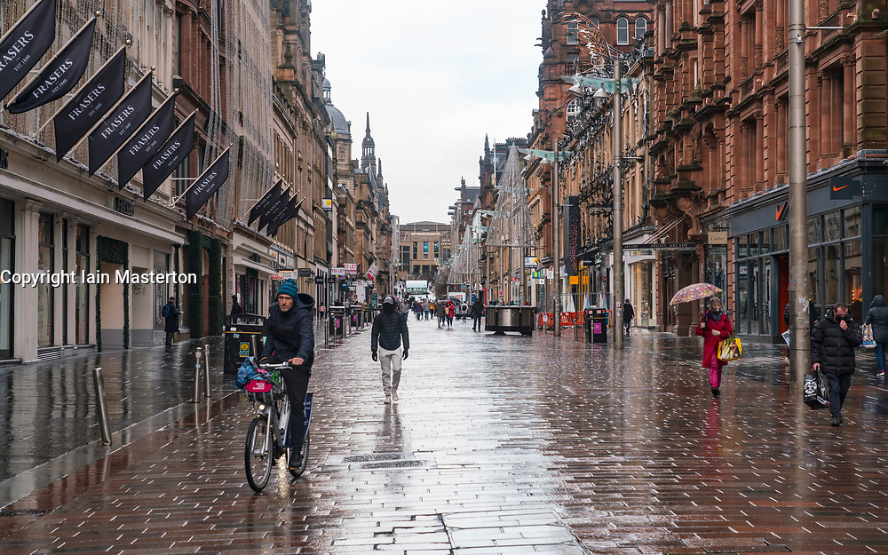 Glasgow,Scotland, UK. 2 November 2020. As Scotland enters new Coronavirus lockdown regulations the central belt and Glasgow are placed in Level 3 . Members of the public are seen out on the streets of central Glasgow for shopping and work. Pictured; A quiet and wet Buchanan Street.   Iain Masterton/Alamy Live News