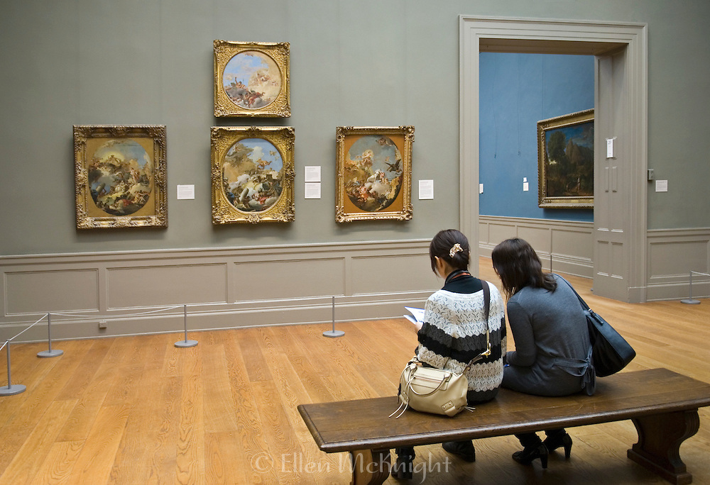 Two Asian women viewing paintings by Giambattista Tiepolo at the Metropolitan Museum of Art in New York City.