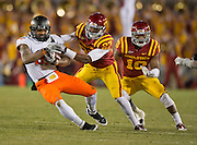 Nov 18, 2011; Ames, IA, USA; Oklahoma State Cowboys Tracy Moore (87) is brought down by Iowa State Cyclones linebacker C.J. Morgan (27) as defensive back Jacques Washington (10) looks on during the first half at Jack Trice Stadium.  Mandatory Credit: Beth Hall-US PRESSWIRE Editorial sports photography of the Iowa State Cyclones vs. Oklahoma State Cowboys in 2011 in Aimes, Iowa.