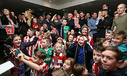 Lincoln City coaches Danny and Nicky Cowley (top right) watch the Emirates FA Cup, Quarter Final draw alongside fans in the Travis Perkins bar at Sincil Bank, Lincoln.