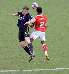 West Ham's Kevin Nolan beats Bristol City's Mark Little in the air. - Photo mandatory by-line: Alex James/JMP - Mobile: 07966 386802 - 25/01/2015 - SPORT - Football - Bristol - Ashton Gate - Bristol City v West Ham United - FA Cup Fourth Round