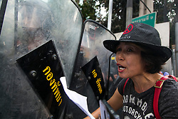 © Licensed to London News Pictures. 24/05/2014. A protestor shouts at Thai Army in riot gear following a Anti-Coup protest in Bangkok Thailand. The Royal Thai army announced a Military coup and have imposed a 10pm curfew.  Photo credit : Asanka Brendon Ratnayake/LNP