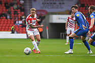 James Coppinger of Doncaster Rovers (26) plays a reverse pass during the EFL Sky Bet League 1 match between Doncaster Rovers and Gillingham at the Keepmoat Stadium, Doncaster, England on 20 October 2018.
