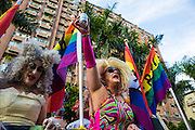 "A drag queen holds her beer aloft at LGBT Pride. The annual march through Taipei's city streets is the largest in Asia, with well over 50 000 people taking part. The 2014 event had the theme ""Walk in Queer's Shoes"", to encourage the wider community to lend their support for equal marriage rights."