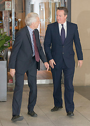 © Licensed to London News Pictures. 28/09/2014. Birmingham, UK. The Prime Minister, David Cameron, is met by Barney Jones the producer of The Andrew Marr Show as he arrives for an Interview.  The Conservative Party Conference in Birmingham 28th September 2014. Photo credit : Stephen Simpson/LNP