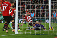 Football - 2018 / 2019 Premier League - Southampton vs. Arsenal<br /> <br /> Southampton's Shane Long pounces on the loose ball to poke home only for the goal to be disallowed for offside at St Mary's Stadium Southampton<br /> <br /> COLORSPORT/SHAUN BOGGUST