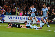 Steffan Jones (l) of the Dragons dives over for the opening try.  Rabodirect pro12, Newport Gwent Dragons v Cardiff Blues at Rodney Parade, Newport,  South Wales on Sat 15th Sept 2012.   pic by  Andrew Orchard, Andrew Orchard sports photography,