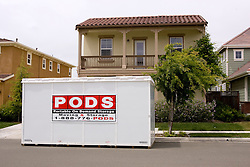 A storage container waiting to be picked up after a foreclosure on the property. The Vallejo, Calif.,couple lost their hometo foreclosure due to a combination of job loss, adjustable loan payments doubling and  home value under water nearly fifty percent. Photo by Kim Kulish