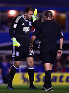 Thomasz Kuszczak , the goalkeeper of Birmingham city holds his face as he has a head injury .EFL Skybet championship match, Birmingham city v Cardiff city at St.Andrew's stadium in Birmingham, the Midlands on Friday 13th October 2017.<br /> pic by Bradley Collyer, Andrew Orchard sports photography.