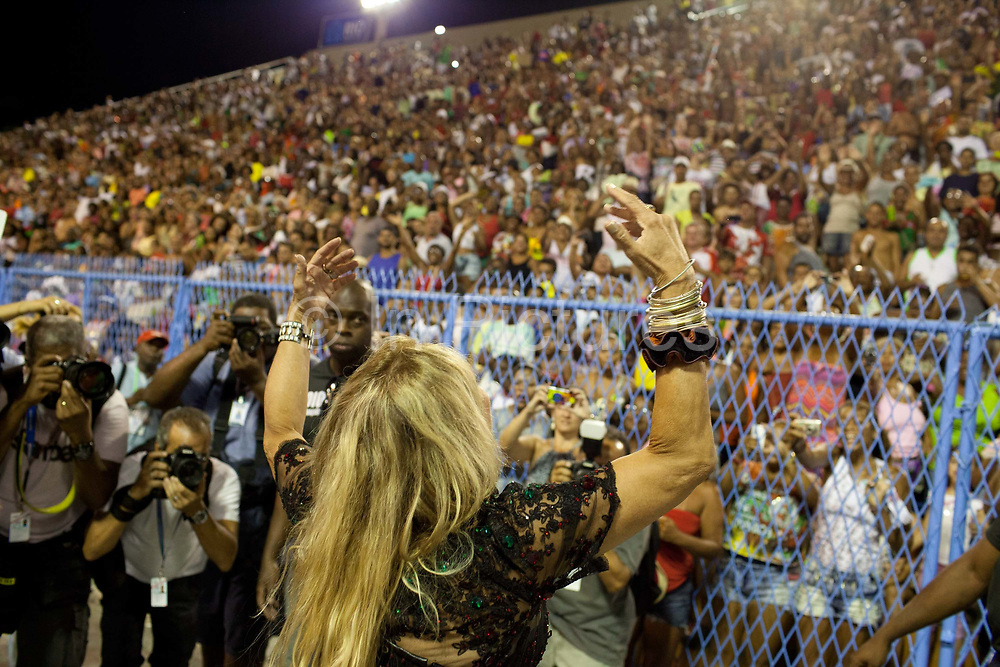 Susana Vieira posing for photos and talking to the fans before their final practice performance, Grande Rio Samba School from the Special Group, practices their Carnival procession in the Sambadrome, Rio de Janeiro, Brazil