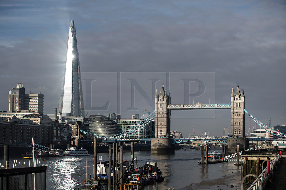 © Licensed to London News Pictures. 18/02/2018. London, UK. Sunshine is reflected from The Shard and is reflected in the River Thames as London experiences warm sunny weather with temperatures expected to reach a high of 10 degrees C today. Photo credit: Peter Macdiarmid/LNP