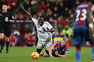 Brede Hangeland of Crystal Palace fouls Bafetimbi Gomis of Swansea City . Barclays Premier League match, Crystal Palace v Swansea city at Selhurst Park in London on Monday 28th December 2015.<br /> pic by John Patrick Fletcher, Andrew Orchard sports photography.