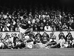 Wimbledon's floored Andy Thorn (No 6) tangles with Arsenal striker Alan Smith.