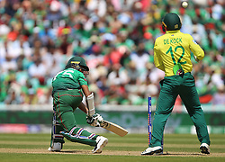 Bangladesh's Shakib Al Hasan is bowled by South Africa's Imran Tahir during the ICC Cricket World Cup group stage match at The Oval, London.