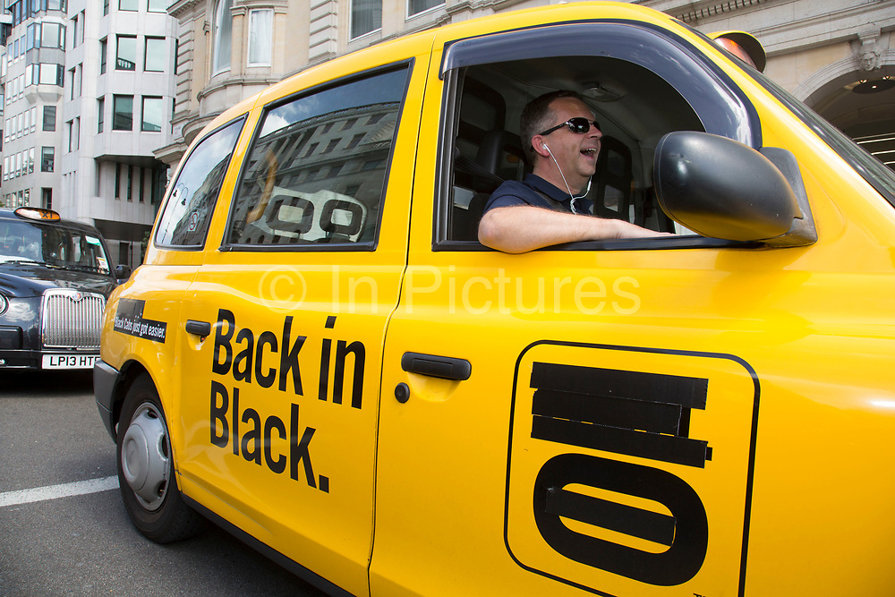 London, UK. Wednesday 11th June 2014. Black taxi drivers protest against taxi service app Uber, brings central London to a standstill. Hail O, a company which set up on the back of the black cab service but is now setting up it's own service is also accused of using them. Joined in many numbers by future black cab drivers on mopeds currently doing 'The Knowledge'. London cabbies emphasised that they had no problem with Uber, only with Transport for London for not enforcing current legislation. Taxi drivers say the Uber app is tantamount to a meter and should be regulated like taxi meters. Uber says it has seen an 850% increase in sign-ups compared to last Wednesday and describes the London Taxi Drivers Association (LTDA), as being stuck in the dark ages.