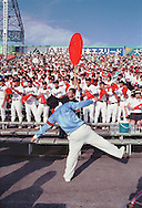 Photo by Torin Boyd<br /> Taken August 18, 2003<br /> Koshien Stadium<br /> Nishinomiya City, Hyogo Prefecture, Japan<br /> <br /> Fans and reserve players root for their team - Shizuoka High School of Shizuoka City (125th anniversary of school this year), and Yazu High School of Yazu County, Tottori Pref.ecture. Shizuoka beat Yazu by a score of 3-2, and eliminated Yazu from the 85th Japan High School Baseball Touranment.