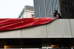 Hong Kong. 4th October 2019. Pro-democracy demonstrations and march in Central district of Hong Kong. Removing PRC 70th anniversary banners.