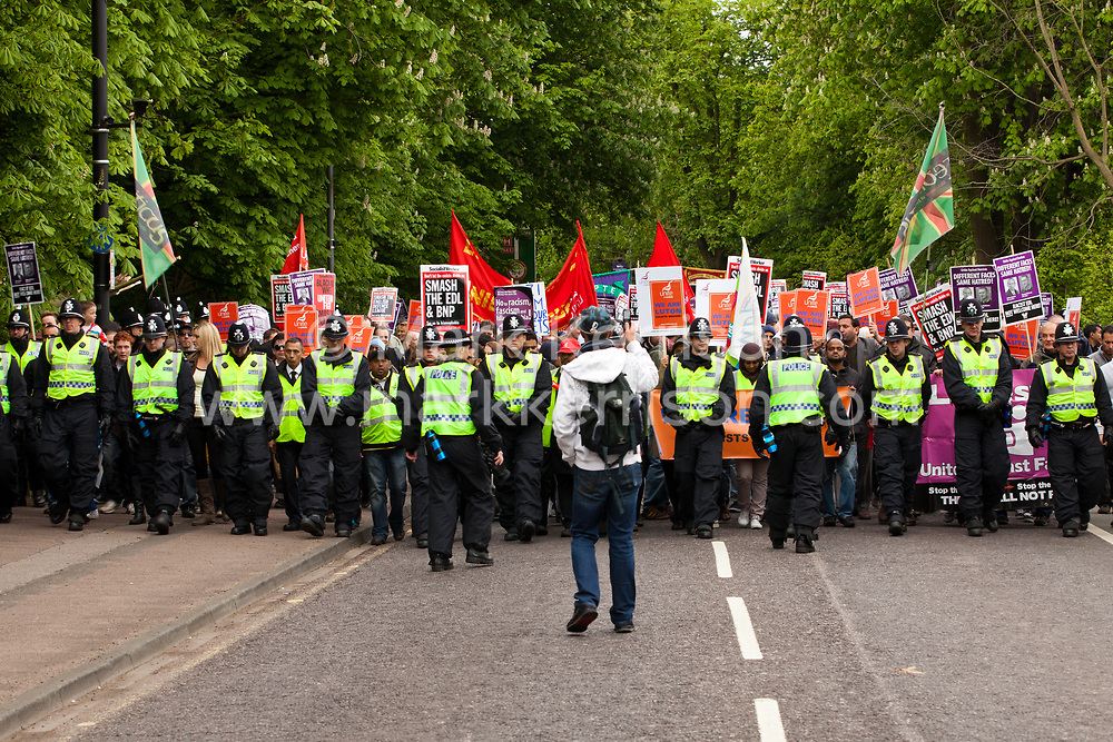 Luton, UK. 5th May, 2012. Police officers form a cordon in front of supporters of We Are Luton and Unite Against Fascism attending the We Are Luton/Stop The EDL march, held in protest against a march by the far-right English Defence League. Around 1,500 police were deployed in Luton for the rival marches from twenty forces around the UK.