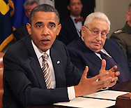 President Barack Obama makes a statement during a meeting with present administration officials and former Secrtaries of State and Defense in the Roosevelt Room of the White House on November 18, 2010.   (left to right.  President Obama, Henry Kissinger, former Secretary of State,  photo by Dennis Brack