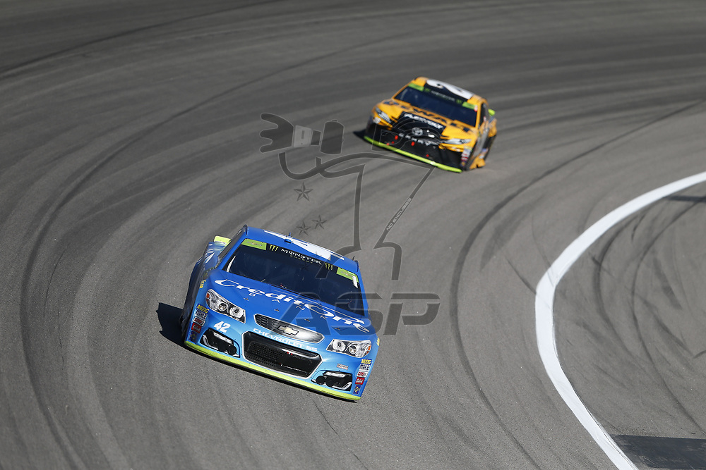 October 22, 2017 - Kansas City, Kansas, USA: Kyle Larson (42) battles for position during the Hollywood Casino 400 at Kansas Speedway in Kansas City, Kansas.