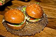 2 mini hamburgers on a platter