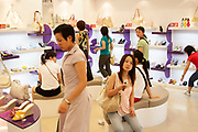 Young Shanghainese woman out shopping for cosmetics at Parksons, one of Shanghais best known department stores in Shanghai, China. This store caters for Western tastes in anything from clothes, to cosmetics, food or electric goods. In such a westernised city, where years ago fashion and modernity did not exist, these places are a Mecca for the young, sometimes affluent youth. Cosmetics are comparatively expensive in Shanghai as in the west, despite the average salary being many times lower. Yet, there is a massive hunger for western goods of all kinds.