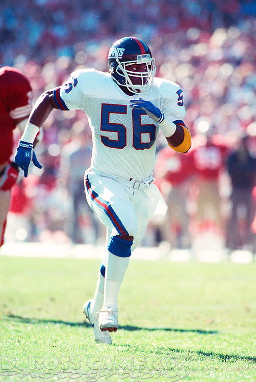 New York Giants linebacker Lawrence Taylor (56) charges into the backfield against the San Francisco 49ers during the first quarter of their NFC Championship football game, Sunday, Jan. 20, 1991 at Candlestick Park in San Francisco. The Giants won, 15-13 and now move on to the Super Bowl against the Buffalo Bills. (Photo by D. Ross Cameron)