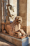 Lions with Atlas on their back holding up a column that supports the canopy above the main portal of the 12th century Romanesque Ferrara Duomo, Italy .<br /> <br /> Visit our ITALY PHOTO COLLECTION for more   photos of Italy to download or buy as prints https://funkystock.photoshelter.com/gallery-collection/2b-Pictures-Images-of-Italy-Photos-of-Italian-Historic-Landmark-Sites/C0000qxA2zGFjd_k<br /> If you prefer to buy from our ALAMY PHOTO LIBRARY  Collection visit : https://www.alamy.com/portfolio/paul-williams-funkystock/ferrara.html
