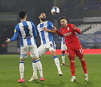 Huddersfield Town's Alex Vallejo in action with  Birmingham City's Ivan Sanchez<br /> <br /> Photographer Mick Walker/CameraSport<br /> <br /> The EFL Sky Bet Championship - Huddersfield Town v Birmingham City - Tuesday 2nd March 2021 - The John Smith's Stadium - Huddersfield<br /> <br /> World Copyright © 2020 CameraSport. All rights reserved. 43 Linden Ave. Countesthorpe. Leicester. England. LE8 5PG - Tel: +44 (0) 116 277 4147 - admin@camerasport.com - www.camerasport.com