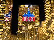 The Helmsley Building lit up in blue and red colors, Manhattan, New York City.