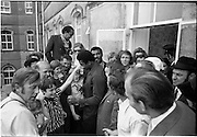 15/07/1972<br /> 07/15/1972<br /> 15 July 1972<br /> Muhammad Ali at Stewarts Hospital Fete, Palmerstown, Dublin. Ali poses with a young fan.