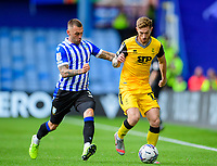 Lincoln City's Ted Bishop vies for possession with  Sheffield Wednesday's Jack Hunt<br /> <br /> Photographer Andrew Vaughan/CameraSport<br /> <br /> The EFL Sky Bet League One - Sheffield Wednesday v Lincoln City - Saturday 23rd October 2021 - Hillsborough Stadium - Sheffield<br /> <br /> World Copyright © 2021 CameraSport. All rights reserved. 43 Linden Ave. Countesthorpe. Leicester. England. LE8 5PG - Tel: +44 (0) 116 277 4147 - admin@camerasport.com - www.camerasport.com