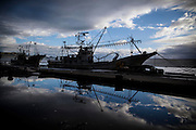 Fishing boats and clouds.