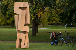 """© Licensed to London News Pictures. 07/10/2020. LONDON, UK. A woman views """"Torre di Saba"""", 2009, by Gianpietro Carlesso at Frieze Sculpture, an annual exhibition of outdoor works by international artists in Regent's Park.  The works are on display to the public until 18 October.  Photo credit: Stephen Chung/LNP"""