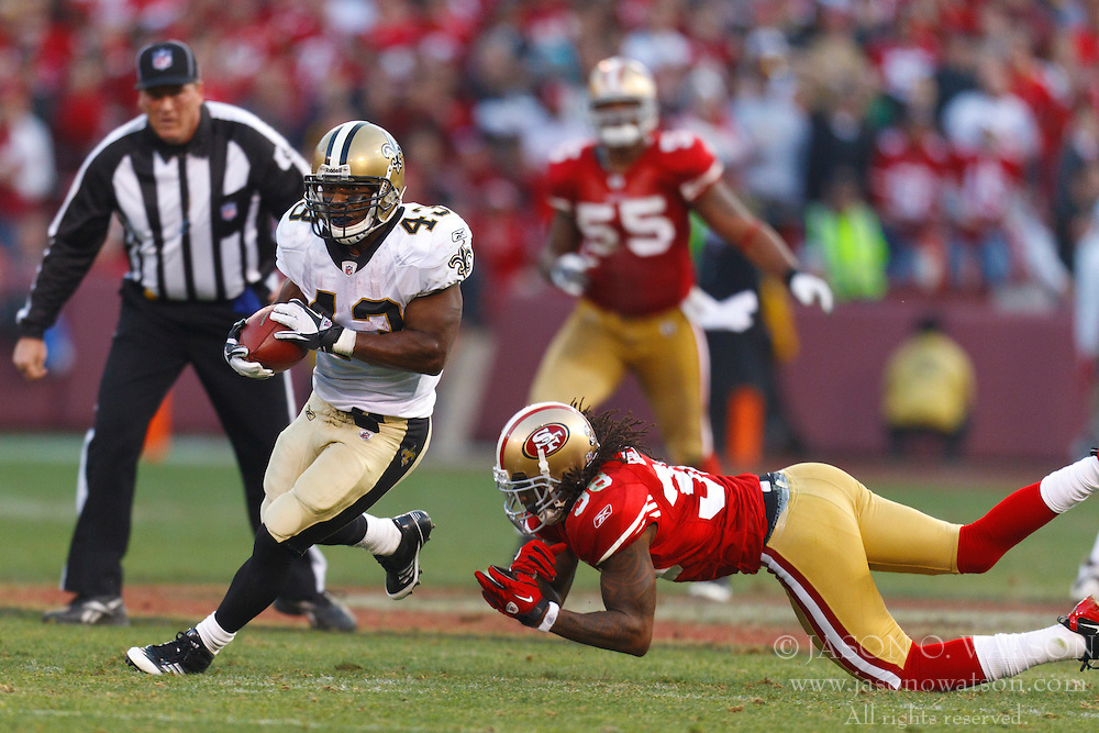 Jan 14, 2012; San Francisco, CA, USA; New Orleans Saints running back Darren Sproles (43) rushes past San Francisco 49ers free safety Dashon Goldson (38) during the fourth quarter of the 2011 NFC divisional playoff game at Candlestick Park. San Francisco defeated New Orleans 36-32. Mandatory Credit: Jason O. Watson-US PRESSWIRE