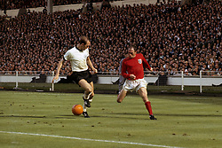 England's Ray Wilson (r) takes on West Germany's Willi Schulz (l)