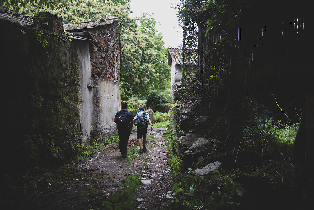 Two people walk the Camino several hours after leaving the town of Samos and just before rejoining the main path at Vigo de Sarria. Samos is a popular detour on the Camino. (July 6, 2018)<br /> <br /> DAY 40: SAMOS TO SARRIA -- 15 KM