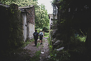 Two people walk the Camino several hours after leaving the town of Samos and just before rejoining the main path at Vigo de Sarria. Samos is a popular detour on the Camino. (July 6, 2018)<br />