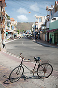 Street scene with old bicycle on footpath.<br /> Vung Tau, Vietnam