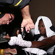 Toka Kahn Clary gets his hands wrapped during theTop Rank boxing event at Osceola Heritage Park in Kissimmee, Florida on September 22, 2016.