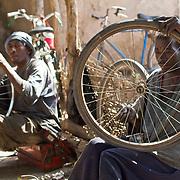 Bicycle repairs at the Sunday market. Near Koumbadiouma in Kolda, Senegal.
