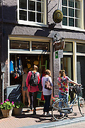 Young women shopping in ladies fashion shop in the Nine Streets shopping district, Amsterdam