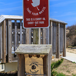 Rehoboth Beach, DE, USA - April 18, 2015: A Leave No Trace Take Your Waste sign at a Delaware State Park.