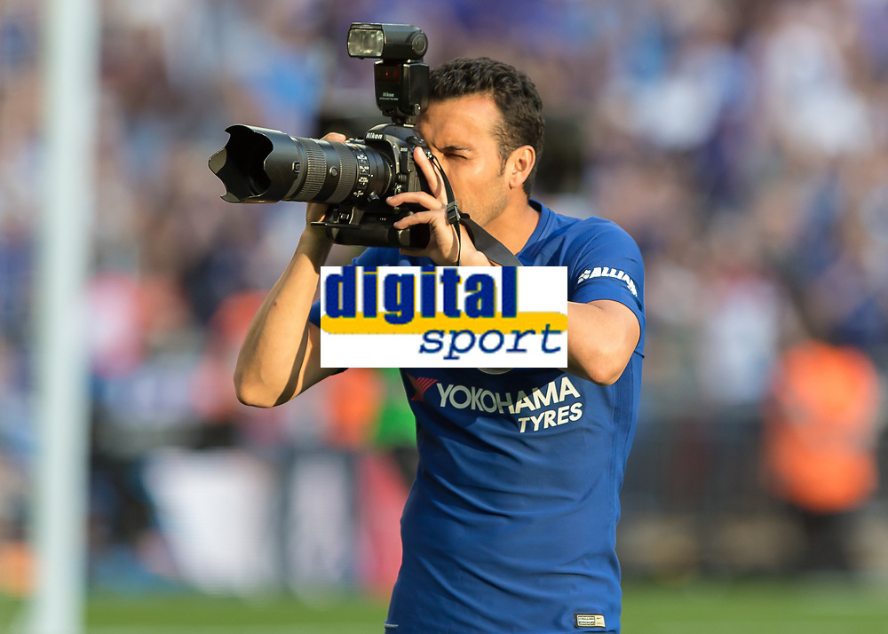Football - 2018 FA Cup Final - Chelsea vs. Manchester United<br /> <br /> Pedro (Chelsea FC) takes aim at the photographers after picking up a loose camera at Wembley Stadium.<br /> <br /> COLORSPORT/DANIEL BEARHAM