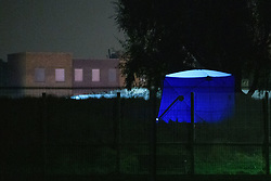 © Licensed to London News Pictures. 19/09/2021. London, UK. A police forensic tent in Cator Park on Kidbrooke Park Road in Greenwich following a call at 17:32BST on Saturday 18/09/2021 to the body of a female found near the community centre. A man was arrested several hours later at approximately 21:20BST at an address in Lewisham on suspicion of murder and was taken into custody at a south London police station. Photo credit: Peter Manning/LNP