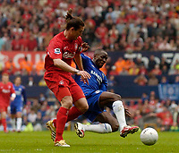 Photo: Glyn Thomas.<br />Chelsea v Liverpool. The FA Cup, Semi-Final. 22/04/2006.<br />Liverpool's Harry Kewell (L) is tackled by Chelsea's Claude Makelele.