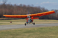 Middletown, New York - The pilot of an experimental aircraft briefly gets airborne  on a runway at  Randall Airport on April 12, 2014. The MX II Sprint ultralight is powered by a four-cycle engine.