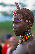 Young man of the Samburu tribe. The Samburu are a Nilotic people of north-central Kenya. Samburu are semi-nomadic pastoralists who herd mainly cattle but also keep sheep, goats and camels.
